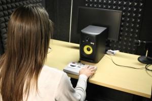 Rebecca preparing the sound booth for a child participant